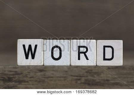 Word, Written In Cubes On Wooden Background