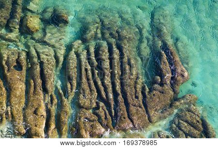 Maltese coastline with emerald sea water and rocks in a water, clear sea in Malta, social issue environment photo, clear sea and stones in water, crystal coast. Malta. Water erosion