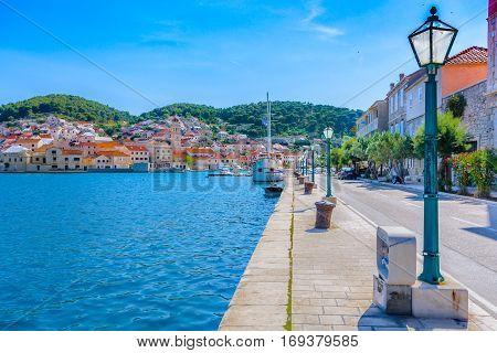Summertime in Pucisca place, small town on Island Brac, Croatia, european travel destination.