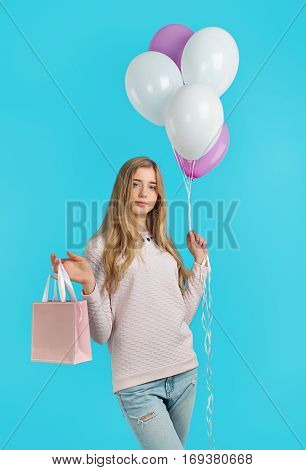 Sweet Nice Girl With Baloons And Little Prersents Bag In The Hands On The Blue Background. Woman's D