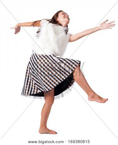 barefoot girl in a dress dances and plays the fool