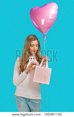 Sweet Nice Girl With Baloons And Little Prersents Bag In The Hands On The Blue Background. Valentine