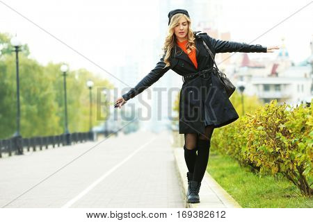 Young beautiful woman on the street