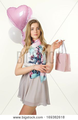 Sweet Nice Girl With Baloons And Little Prersents Bag In The Hands. Woman's Day.