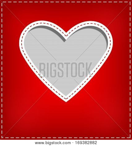 Heart cutout in red card on grey background