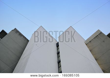 Abstract architecture background. Vanishing point against a blue sky. Empty copy space for Editor's text.