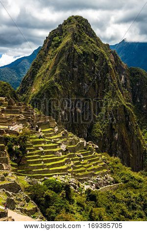 View of the Lost Incan City of Machu Picchu near Cusco, Peru. Machu Picchu is a Peruvian Historical Sanctuary. People can be seen on foreground.