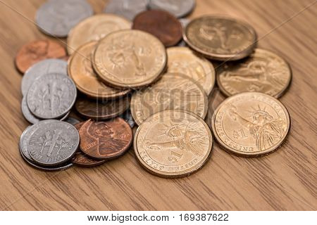 Us One Dollar Coin On The Desk.