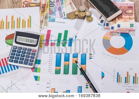 Financial Close-up Background. Financial Accounting Graphs, Euro, Pen, Phone And Calculator.