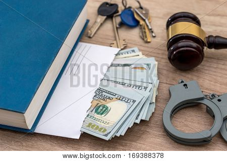 Corruption. Dollars In An Envelope, Handcuffs, Gavel And Book Judge.