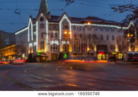 Blurry background - Central part of the Dnepr city with hotel Ukraine at evening time