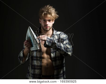 Man In Shirt With Iron