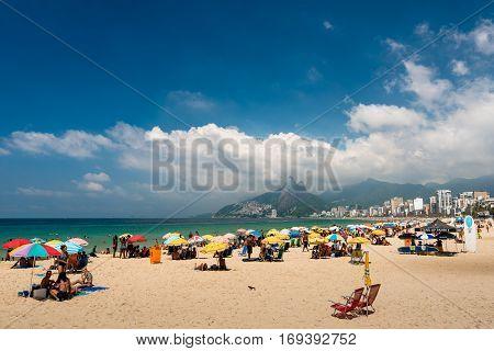 Rio de Janeiro, Brazil - January 15, 2017: People enjoy sunny weekend in famous Ipanema beach in Rio de Janeiro.