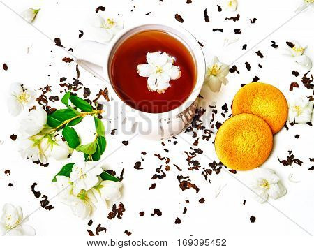 Tea Cup With Dried And Fresh Jasmine Flowers And Biscuits