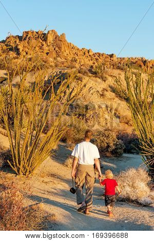 Boy and dad walking the trail in Joshua tree national park, California