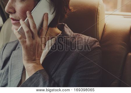 Businesswoman Talking Using Phone Car Inside