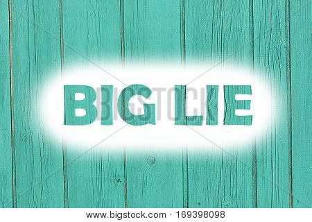 Big Lie Words Print On The Wooden Plate