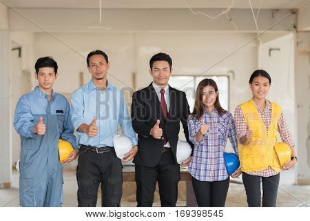 Group of engineers architects and foreman at a construction site