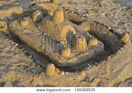 Simple beach  sand castle designed by  children on a Mexican  beach