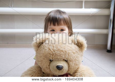 Kid With Teddy Bear Toy