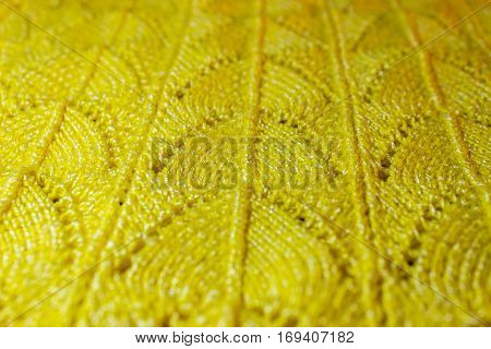 Beautiful yellow background with a knitted pattern.
