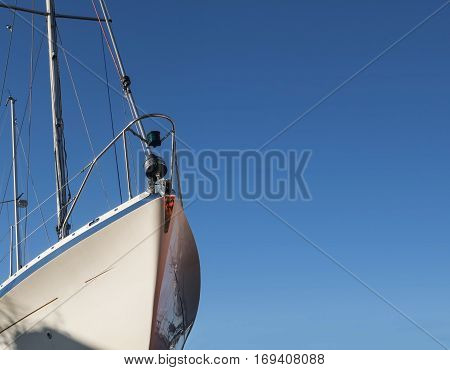 Bow of a white sailing yacht against the blue sky generous copy space selected focus