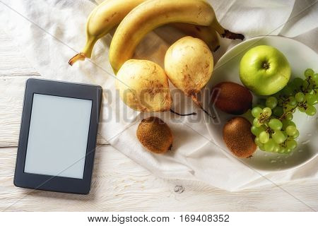 ingredients for fruit salad and ebook top view