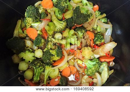 Stir-fry vegetables with broccoli crowns and stems, onions, carrots, and celery