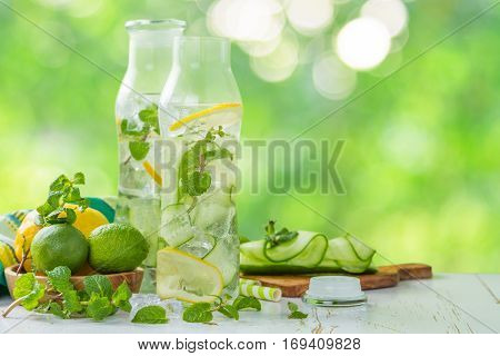 Infused lemon and cucumber water, copy space, outside