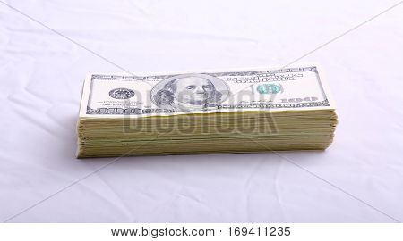 Stacks of American money isolated on white with room for your text. Serial Numbers removed. Fat Stacks of Cold Hard Cash.