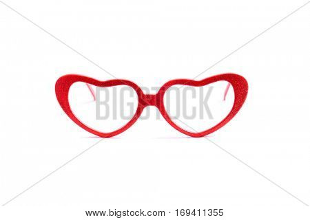 A pair of pink heart shaped sun glasses isolated on white background. Valentines Day Fashion Heart Shaped Sunglasses. Fashion Glasses. Isolated on white with room for your text.