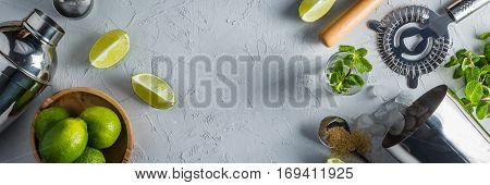 Mojito cocktail and ingredients, rustic wood background, copy space