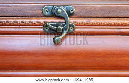 original lock on an old wooden casket