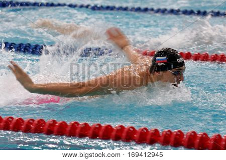 ST. PETERSBURG, RUSSIA - DECEMBER 17, 2016: Athlete competes in 100 m butterfly swimming competition during X Salnikov Cup. Athletes from 6 countries participated in the competitions