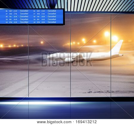 Non flying weather at airport, white plane in snowstorm