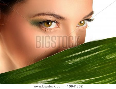 close-up eyes and green leaf