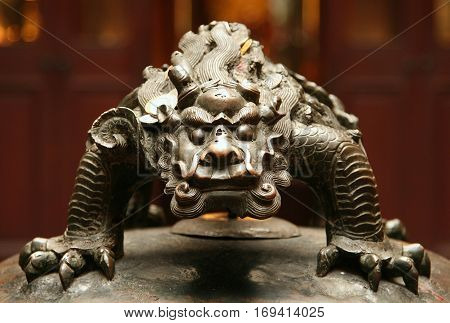 bronze figure of chinese mythological beast closeup