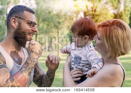 Happy Family With Child Having Fun At The Park
