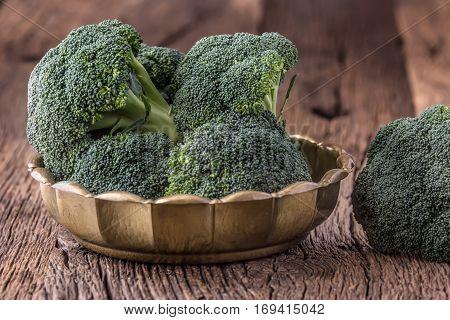 Broccoli.Raw fresh broccoli on old wooden table.