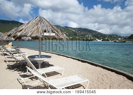 Empty beach chairs in front of Lindbergh Bay on St. Thomas island (U.S.Virgin Islands).
