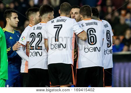 VALENCIA, SPAIN - JANUARY 3: Valencia players talking with refereee during King Cup soccer match between Valencia CF and Celta de Vigo at Mestalla Stadium on January 3, 2017 in Valencia, Spain