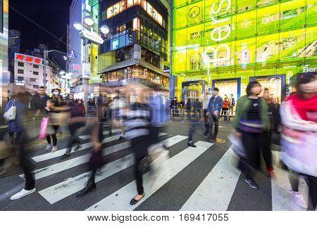 TOKYO, JAPAN - NOVEMBER 12, 2016: Pedestrians crosswalk at Shibuya district in Tokyo, Japan. Shibuya Crossing is one of the busiest crosswalks in the world.
