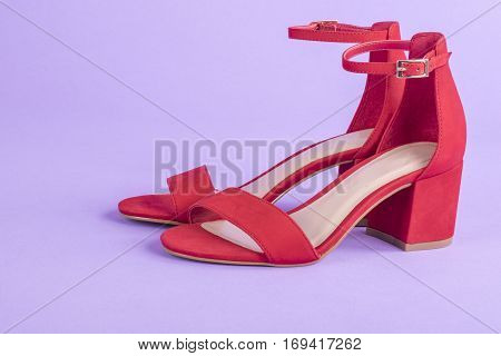 Women's Red Suede Leather Sandals on Purple Background
