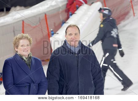 STOCKHOLM SWEDEN - JAN 31 2017: Smiling Swedish Prime Minister Stefan Loeven and Swedish Prime Minister Stefan Loeven and Finance Commissioner Karin Wanngard responisble for the prize ceremonie in the parallel slalom downhill alpine skiing event Audi FIS