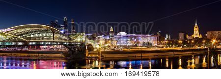 Moscow Russia - January 20 2017: Night winter panorama of the Moskva River embankment: pedestrian bridge Bogdan Khmelnitsky Kiyevskaya railway station Moscow-City Redisson Slavyanskaya hotel