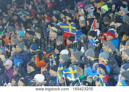 STOCKHOLM SWEDEN - JAN 31 2017: Happy audience with swedish flags in the parallel slalom event at the Alpine Audi FIS Ski World Cup - city event January 31 2017 Stockholm Sweden