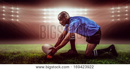 Rugby player keeping ball on kicking tee against spotlight and copy space 3d