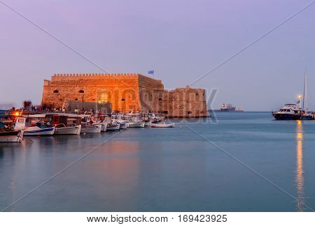 View of the medieval Venetian Castle and Heraklion port at sunset. Crete. Greece.
