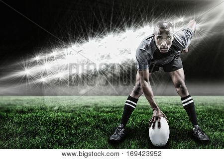 Portrait of sportsman playing rugby against spotlights and copy space 3d