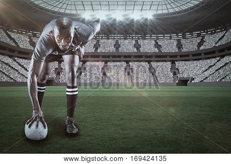 Portrait of rugby player smiling against rugby stadium with copy space 3d